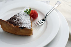 Strawberry and Chocolate dessert with fork; wide view. Closely cropped shot from above of a Chocolate cheesecake dessert slice with a cut strawberry for styling Royalty Free Stock Photography