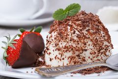 Strawberry in chocolate and dessert panna cotta on a plate. Closeup horizontal Stock Photo