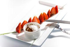 Strawberry in chocolate fondue royalty free stock images