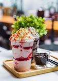 Strawberry and chocolate frappe with whipped cream. On table royalty free stock photo