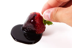 Strawberry and chocolate with hand. Strawberry dipped in chocolate fondue, valentine's day  on a white background Stock Photos