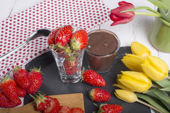 Strawberry and chocolate pot with tulips Stock Photography