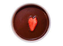Strawberry and Chocolate. A ripe red strawberry in chocolate dipping sauce stock image