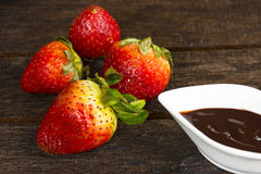 Strawberry with chocolate sauce Fruit or food and snack. Close upn Stock Photos