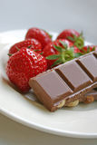 Strawberry and chocolate treat. Fresh strawberries and chocolate bar treat Stock Photos