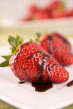 Strawberry in chocolate on white plate Stock Photo