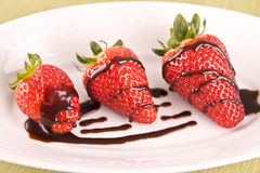 Strawberry in chocolate on white plate Royalty Free Stock Photo