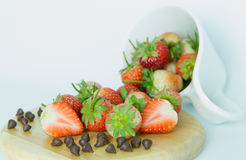 Strawberry and chocolate. On the wood and white background Stock Photography