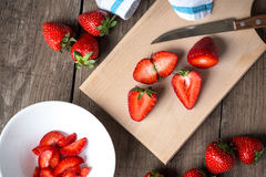 Strawberry on chopping wooden board Stock Image
