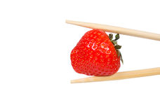 Strawberry and chopsticks Royalty Free Stock Photography