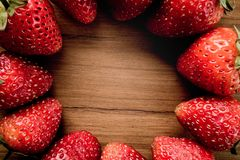 Strawberry circle on wooden Royalty Free Stock Image