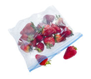 Strawberry in clear plastic bag. Isolated on white background Royalty Free Stock Photo