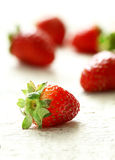 Strawberry close up with a back light on a white background.  Royalty Free Stock Photos