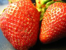 Strawberry close-up. Strawberry lies on a black table, close-up Stock Images