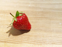 Strawberry. Close up strawberry on a wooden board Stock Photography