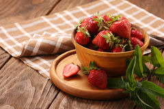 Strawberry close up in a wooden bowl Stock Photo