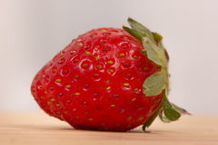 Strawberry in closeup on o wooden table Royalty Free Stock Image