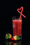 Strawberry cocktail. Glass of strawberry cocktail and strawberries isolated on a black background Stock Photo
