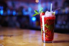 Strawberry cocktail. With ice on a forward background royalty free stock image