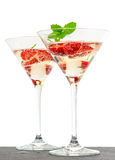Strawberry cocktail with berries in martini glass. Isolated on white background. Festive arrangement with sparkling wine and fresh fruits. selective focus Stock Images