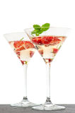 Strawberry cocktail with berry in martini glass isolated on whit. E background. festive arrangement with sparkling wine and fresh berries. selective focus Royalty Free Stock Photos