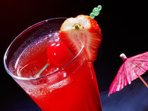 Strawberry  cocktail  with cherry and umbrella Royalty Free Stock Images
