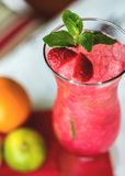 Strawberry cocktail decorated with mint in glass Stock Images
