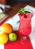 Strawberry cocktail decorated with mint in glass Stock Photo