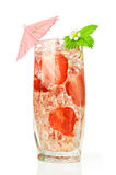 Strawberry cocktail with fresh berries and umbrella Stock Image