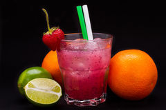 Strawberry cocktail in glass with straw on black background royalty free stock image