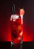 Strawberry cocktail with ice on black table Stock Image