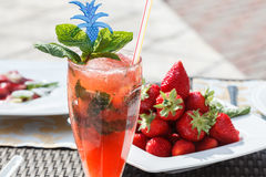 Strawberry cocktail. With ice and mint Stock Photos