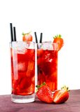 Strawberry cocktail with ice on old wood table Stock Images