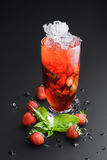 Strawberry cocktail  lemonade  on a dark uniform background with Strawberry Royalty Free Stock Photos