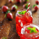 Strawberry cocktail. Old fashioned jars with vivid red strawberry cocktail royalty free stock photo