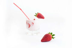 Strawberry and cocktail. One strawberry and cocktail in background stock photo