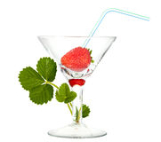 Strawberry with cocktail straw in glass and sprout Royalty Free Stock Images