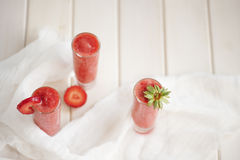 Strawberry cocktail on the wooden white table Stock Image