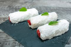 Strawberry and coconut cake stock photos