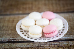 Strawberry and coconut macarons. On a knitted white plate Stock Photography