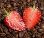 strawberry in coffee beans Stock Photography