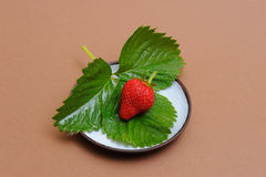 Strawberry on Coffee Saucer Stock Images
