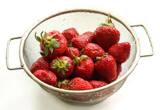 A strawberry is in a colander Royalty Free Stock Images