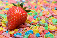 Strawberry and colorful cereal. Image of fresh red strawberry with colorful cereal as background (symbolize of healthy food/ healthy lifestyle concept Stock Photography