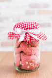 Strawberry cookies in glass canister, cap with plaid fabric Stock Images