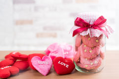 Strawberry cookies in glass canister, cap with plaid fabric Royalty Free Stock Image