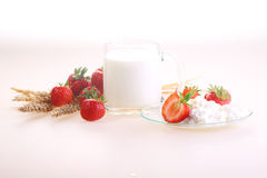 Strawberry, cottage cheese and milk in a transparent mug on a wh. Ite background stock images