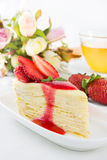 Strawberry crape cake with tea cup Stock Photos
