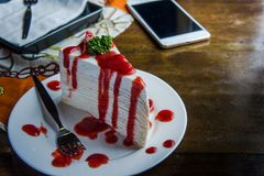 Strawberry crape cake on wood table in coffee shop , dessert tas Royalty Free Stock Images