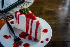 Strawberry crape cake on wood table in coffee shop , dessert tas Royalty Free Stock Photo